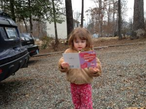 Reading her Valentine's Day card from Great-Grandma.