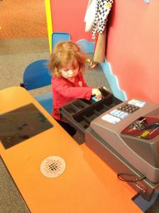 Teaching McKenna the value of school by forcing her to run a register.