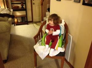 McKenna improved the location of her booster seat by moving it to a location that enabled her to watch Barney and eat simultaneously.